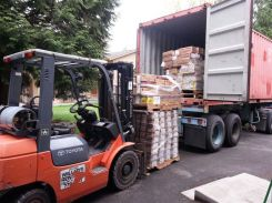Loading the container with the toys Hasbro donated