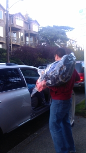 Dr. Hassan loading his car with items he is taking to the warehouse from our office.