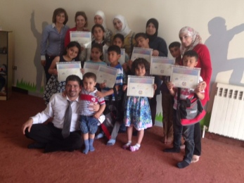 Teachers and children with their certificates from the Malki-SCM Center