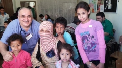 Dr. Eiad Sayed, the leader of this mission, with children and patients on June 1
