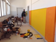 Our crew of humanitarian volunteers painting the school