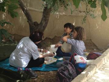 Jill Cole, one of our humanitarians, with the children in Madaba