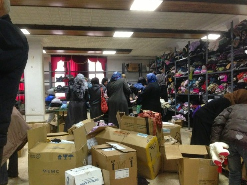 Boxes from the container, distribution of clothes and supplies