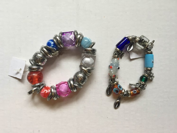 Silver and glass charm bracelets; Large & Small