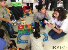 Children with special needs checking out the toys donated to SCM